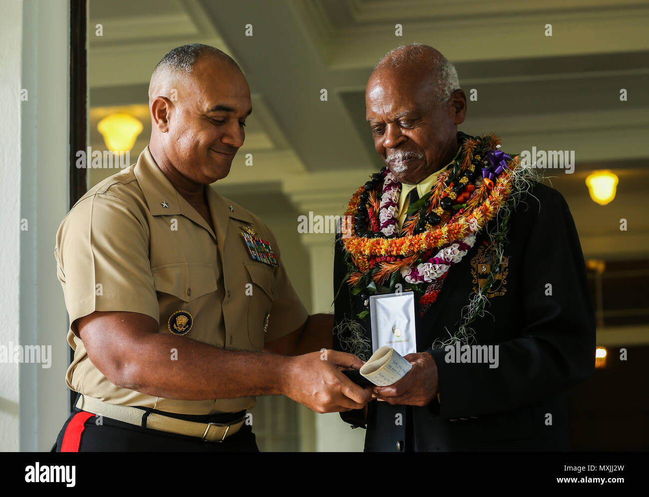 U.S. Marine Corps Brig. Gen. Brian W. Cavanaugh, deputy commander of U.S. Marine Corps Forces, Pacific, presents the Congressional Gold Medal to Dr. Ernest James Harris, Jr. in Honolulu Nov. 12, 2016. Harris was awarded his Congressional Gold Medal for his service as a Montford Point Marine. (U.S. Marine Corps photo by Cpl. Wesley Timm) - Stock Image