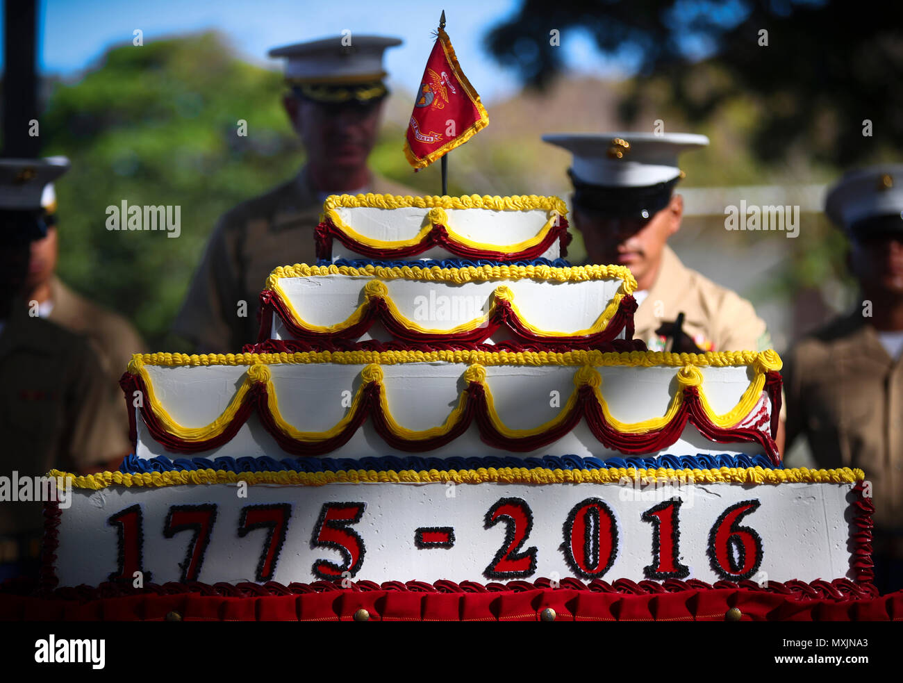 U.S. Marines assigned to Headquarters Battalion, Marine Corps Base Hawaii (MCBH), prepare to present the birthday cake during the annual Birthday Uniform Pageant at Dewey Square aboard MCBH, Nov. 9, 2016. (U.S. Marine Corps Photo by Cpl. Aaron S. Patterson) - Stock Image