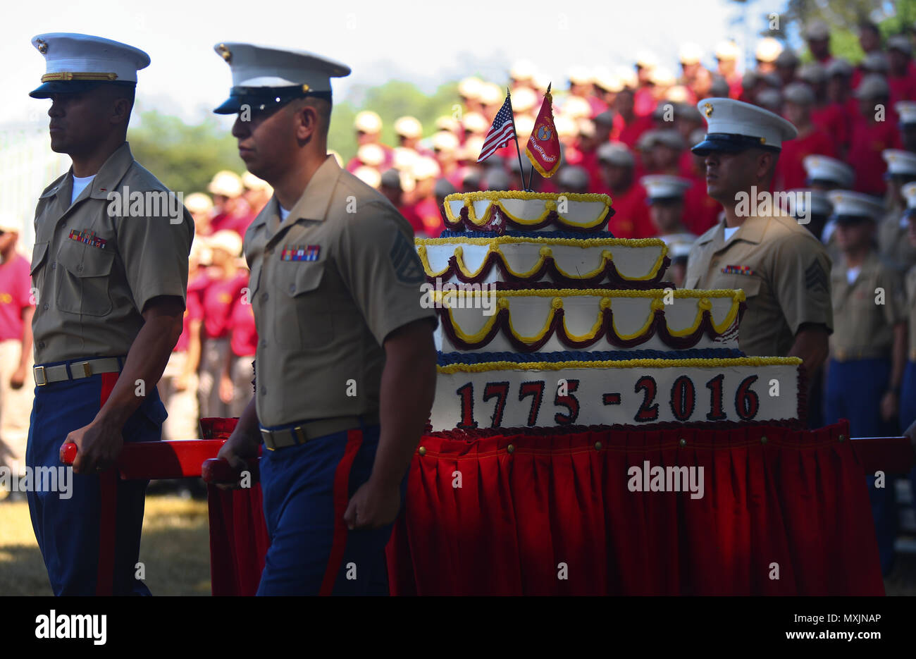 U.S. Marines assigned to Headquarters Battalion, Marine Corps Base Hawaii (MCBH), delivers the birthday cake during the annual Birthday Uniform Pageant at Dewey Square aboard MCBH, Nov. 9, 2016. (U.S. Marine Corps Photo by Cpl. Aaron S. Patterson) - Stock Image