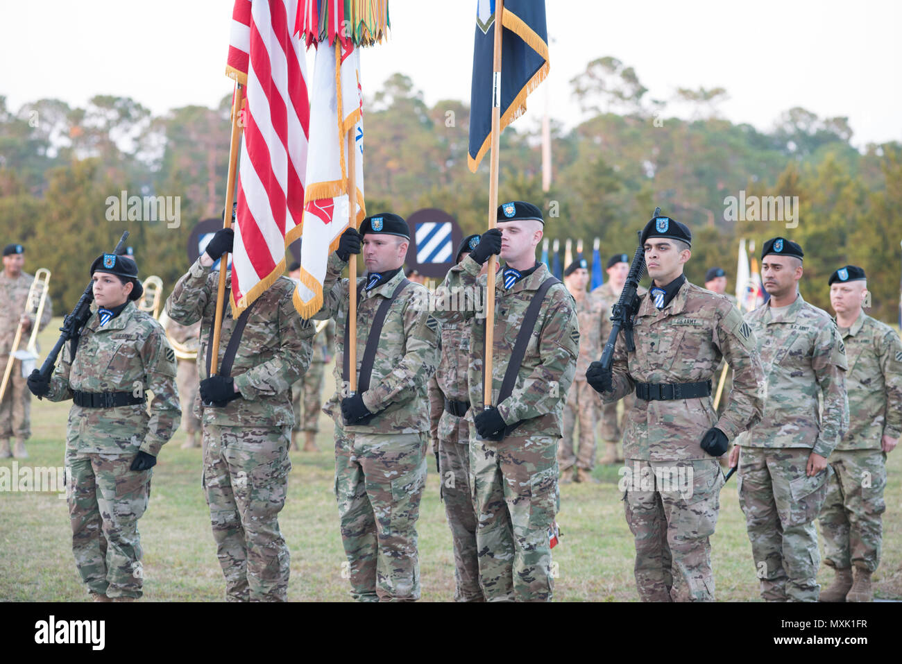 The 3rd Infantry Division color guard participates in the annual Twilight Tattoo during Marne Week at Fort Stewart Nov. 15, 2016. Twilight Tattoo is a ceremony honoring veterans and family members. (Photo by LTC Brian J. Fickel) - Stock Image