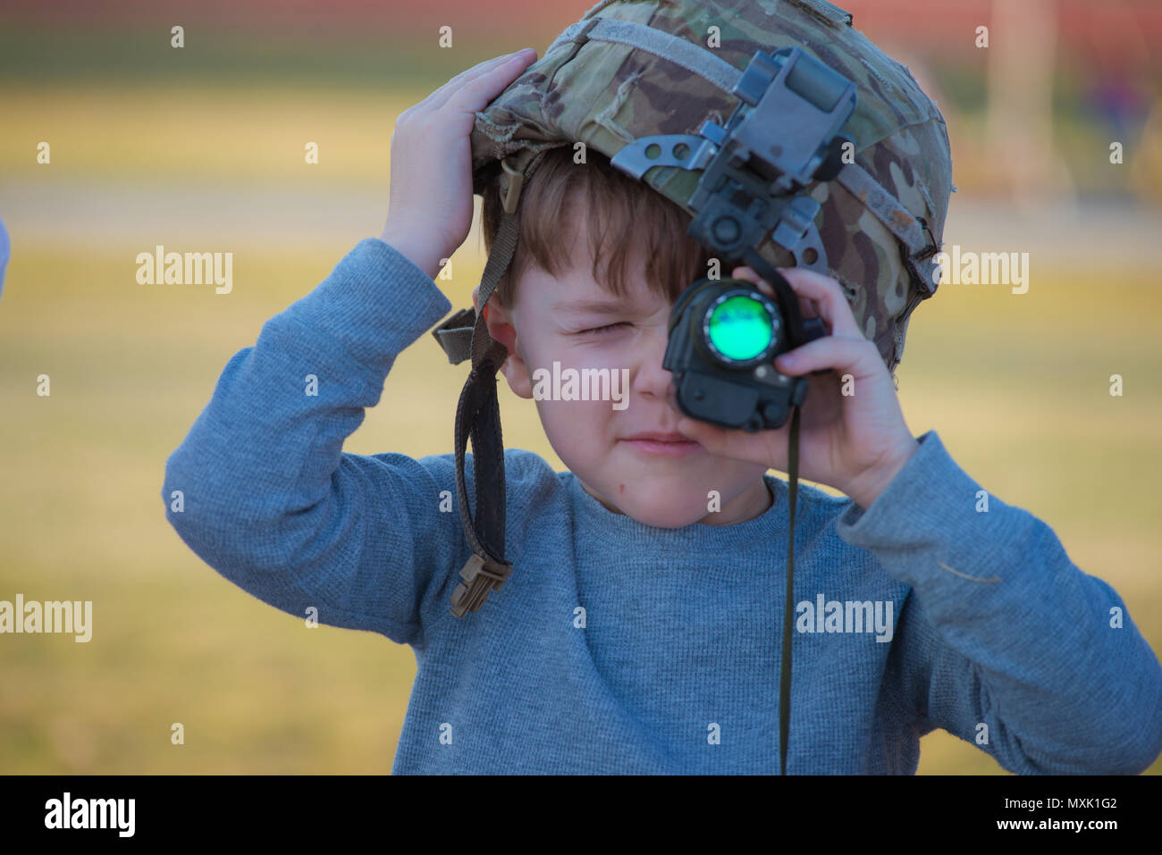 A 3rd Infantry Division family member peers through an optic at a static display during Marne Week on Fort Stewart Nov. 15, 2016. Marne Week is a week of special activities for soldiers and family members in celebration of the 99th anniversary of the 3rd Infantry Division. (Photo by LTC Brian J. Fickel) - Stock Image