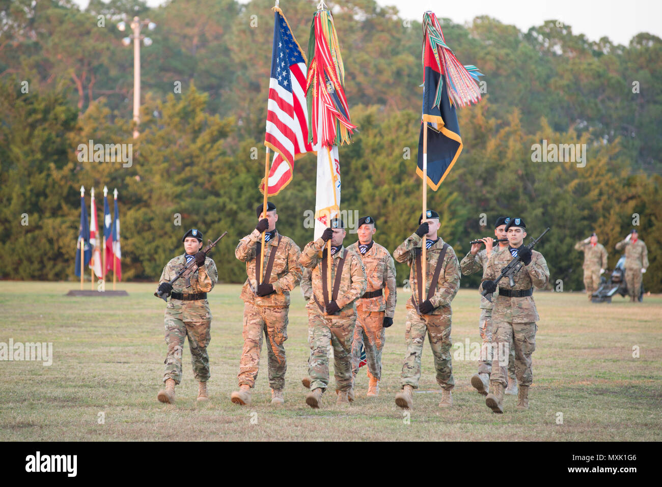 The 3rd Infantry Division color guard participates in the annual Twilight Tattoo during Marne Week at Fort Stewart Nov. 15, 2016. Twilight Tattoo is a ceremony honoring veterans and family members. (Photo by LTC Brian J. Fickel) Stock Photo