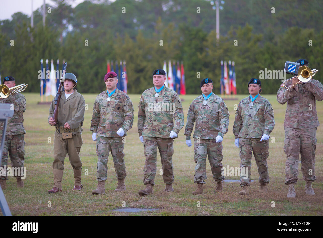 Members of the 3rd Infantry Division Audie Murphy Club participate in the Twilight Tattoo ceremony at Fort Stewart Nov. 15, 2016 during Marne Week. Twilight Tattoo is a ceremony honoring veterans and family members. (Photo by LTC Brian J. Fickel) - Stock Image