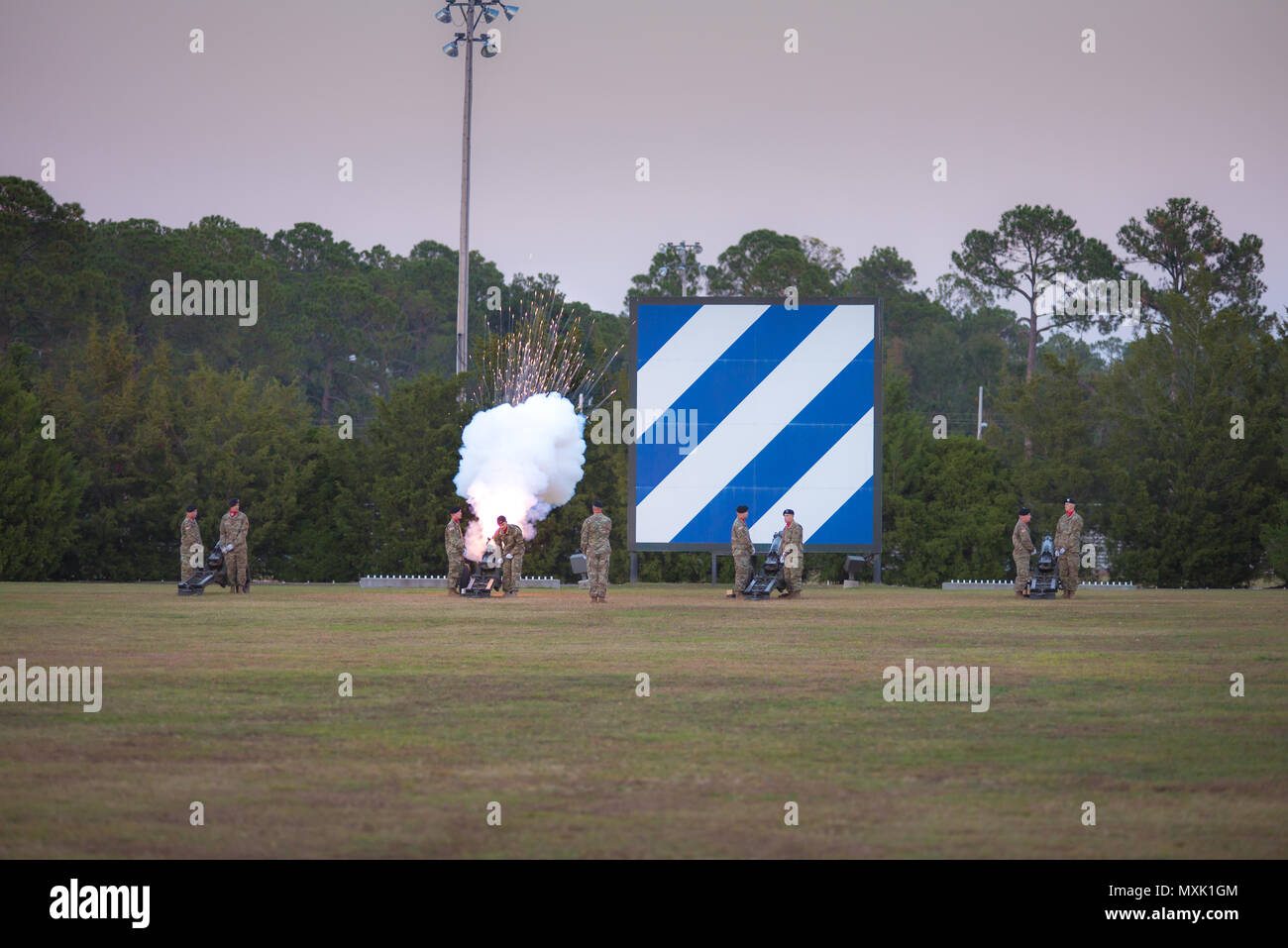 A salute battery assigned to 3rd Infantry Division Artillery performs during the Twilight Tattoo ceremony at Fort Stewart Nov. 15, 2016. Twilight Tattoo is a cermony honoring veterans and family members. (Photo by LTC Brian J. Fickel) - Stock Image