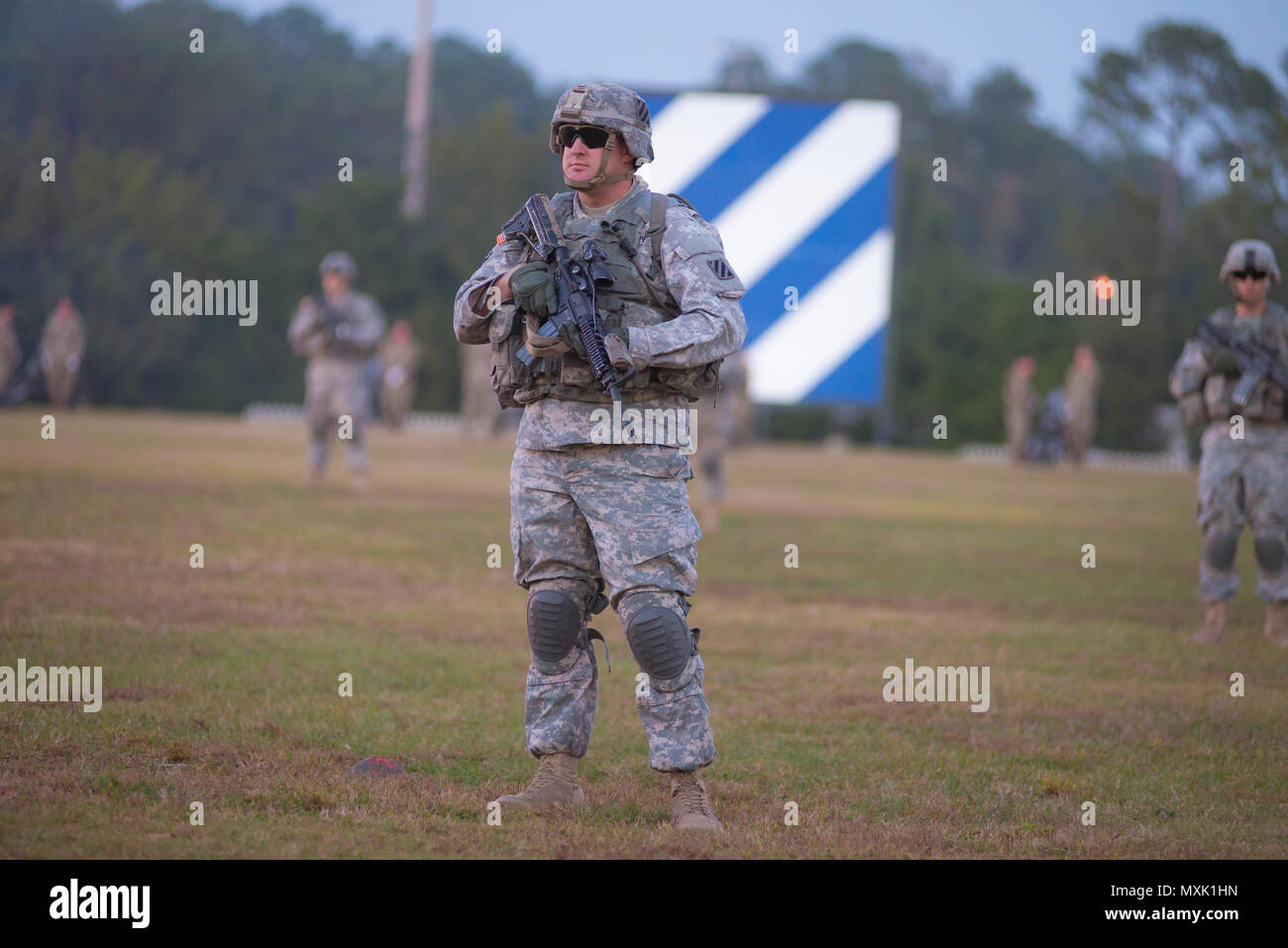 A 3rd Infantry Division infantry squad participates in Twilight Tattoo at Fort Stewart Nov. 15, 2016. (Photo by LTC Brian J. Fickel) - Stock Image