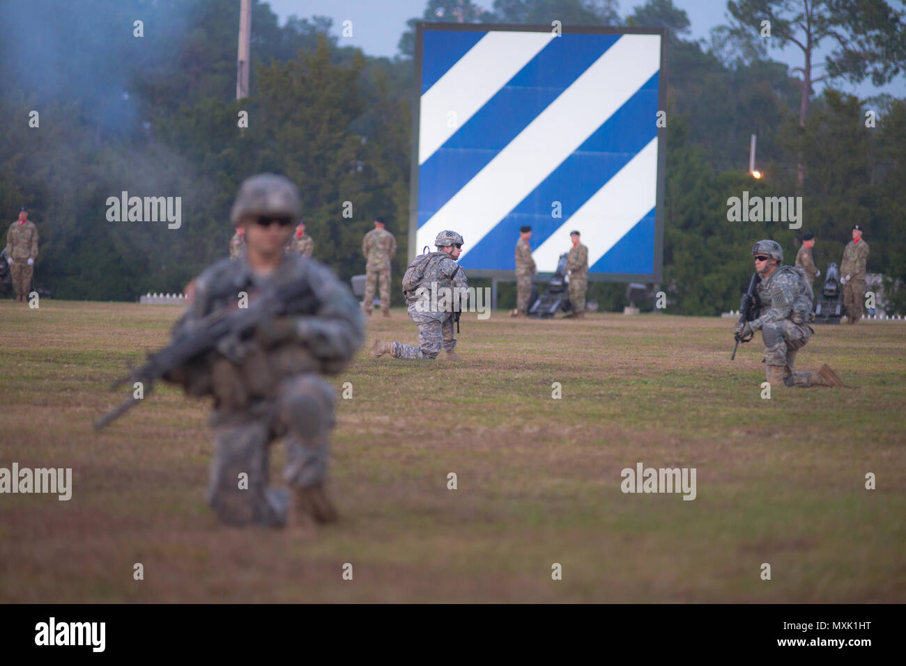 A 3rd Infantry Division infantry squad participates in Twilight Tattoo at Fort Stewart Nov. 15, 2016. (Photo by LTC Brian J. Fickel) Stock Photo