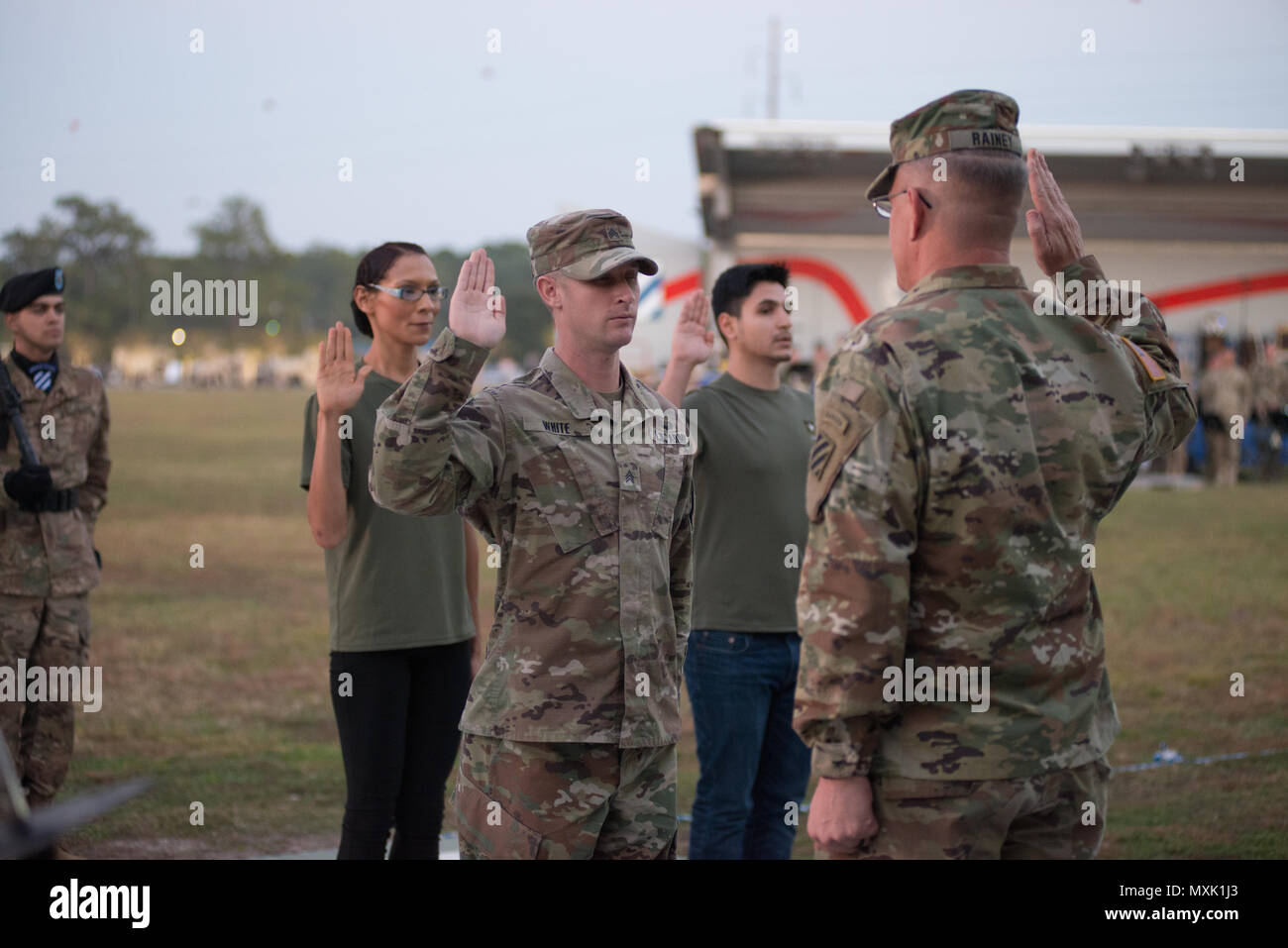 Maj. Gen. Jim Rainey, commanding general of 3rd Infantry Division reenists soldiers assigned to Fort Stewart during Twilight Tattoo Nov. 15, 2016. Twilight Tattoo is a ceremony honoring veterans and family members. (Photo by LTC Brian J. Fickel) Stock Photo