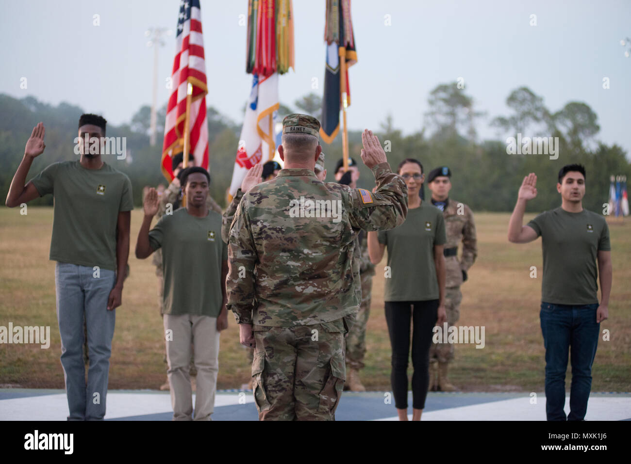 Maj. Gen. Jim Rainey, commanding general of 3rd Infantry Division reenists soldiers assigned to Fort Stewart during Twilight Tattoo Nov. 15, 2016. Twilight Tattoo is a ceremony honoring veterans and family members. (Photo by LTC Brian J. Fickel) - Stock Image