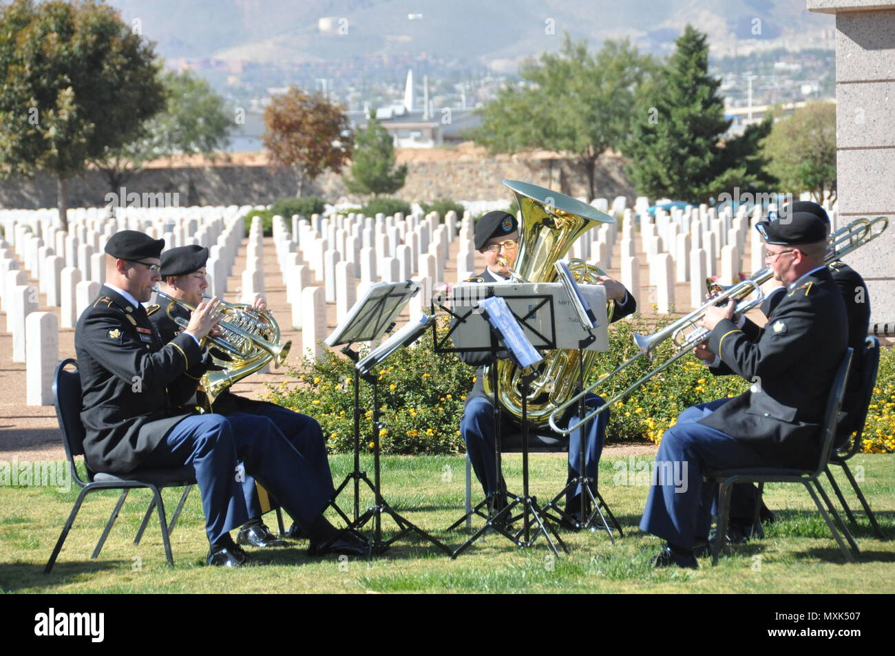 """Members of the 1st Armored Division Band performed the U.S. and German national anthems, """"Goin' Home,"""" """"Holst Suite Number 2 – Song Without Words,"""" and """"Der Gute Kamerad"""" during the German National Day of Mourning ceremony at Fort Bliss National Cemetery Nov. 13, 2016. - Stock Image"""