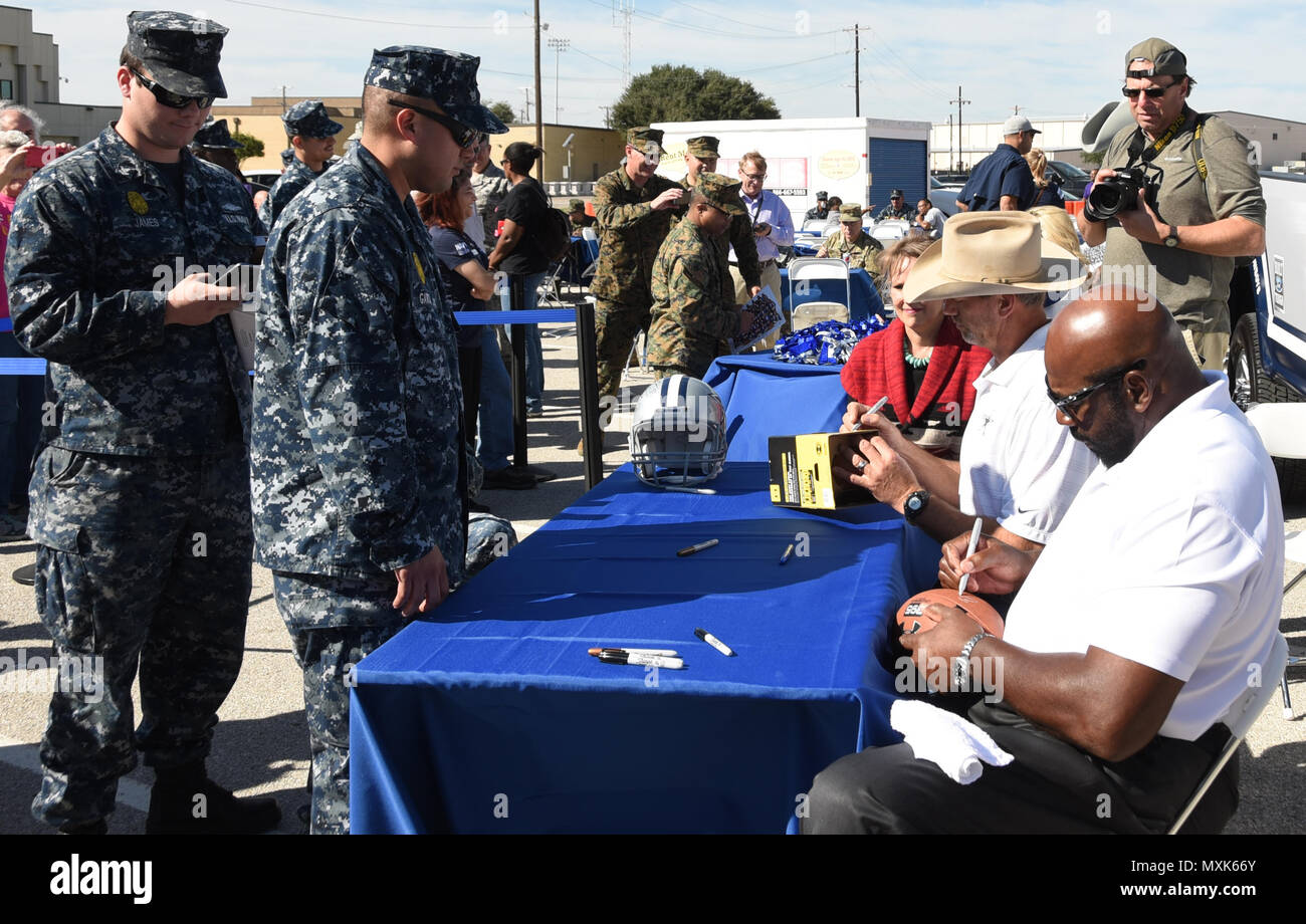 Dallas cowboys alumni jay novacek and ed too tall jones sign dallas cowboys alumni jay novacek and ed too tall jones sign autographs during the built ford tough tailgate and dallas cowboys barbecue at naval air m4hsunfo