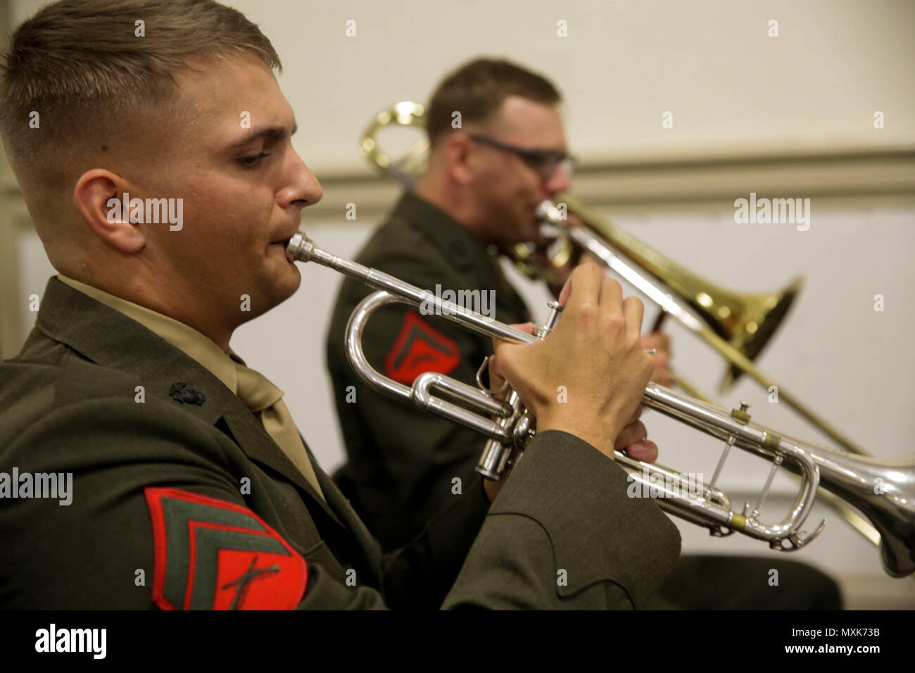 A Marine band member plays the trumpet during the Purple Star Memorial Ceremony at Camp Lejeune, N.C., May 5th, 2017. Marines conducted the Purple Star Memorial to honor the fallen Marines and sailors of Exercise Purple Star. The Marines are with 2nd Battalion, 8th Marine Regiment, 2nd Marine Division. - Stock Image