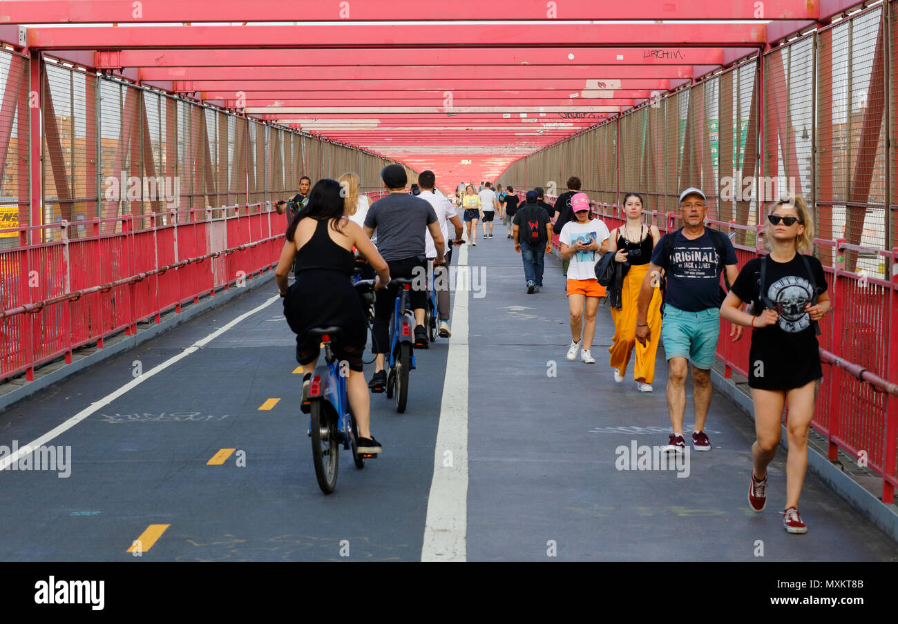 Bicyclists and Pedestrians on the Williamsburg Bridge walkway - Stock Image