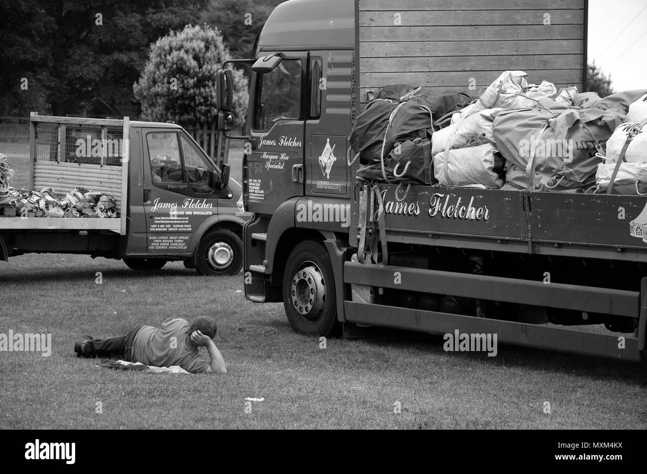 Marquee company employee resting after the Northumberland County Show,Bywell, Northumberland - Stock Image