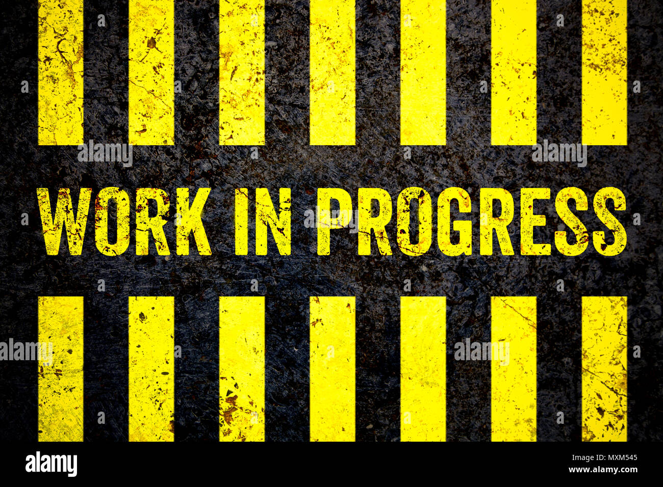 Work in progress warning sign with yellow and black stripes painted over cracked concrete wall coarse texture background. Concept for do not enter the - Stock Image