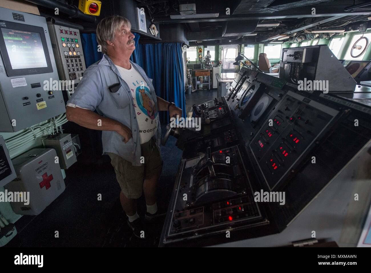 161116-N-RX777-014  ARABIAN GULF (Nov. 16, 2016) William Bostwick stands watch as helmsman on the bridge of the fast combat support ship USNS Arctic (T-AOE 8).  Arctic is deployed supporting coalition maritime forces ships in the U.S. 5th Fleet area of operations. (U.S. Navy Photo by Petty Officer 3rd Class Cole Keller) - Stock Image