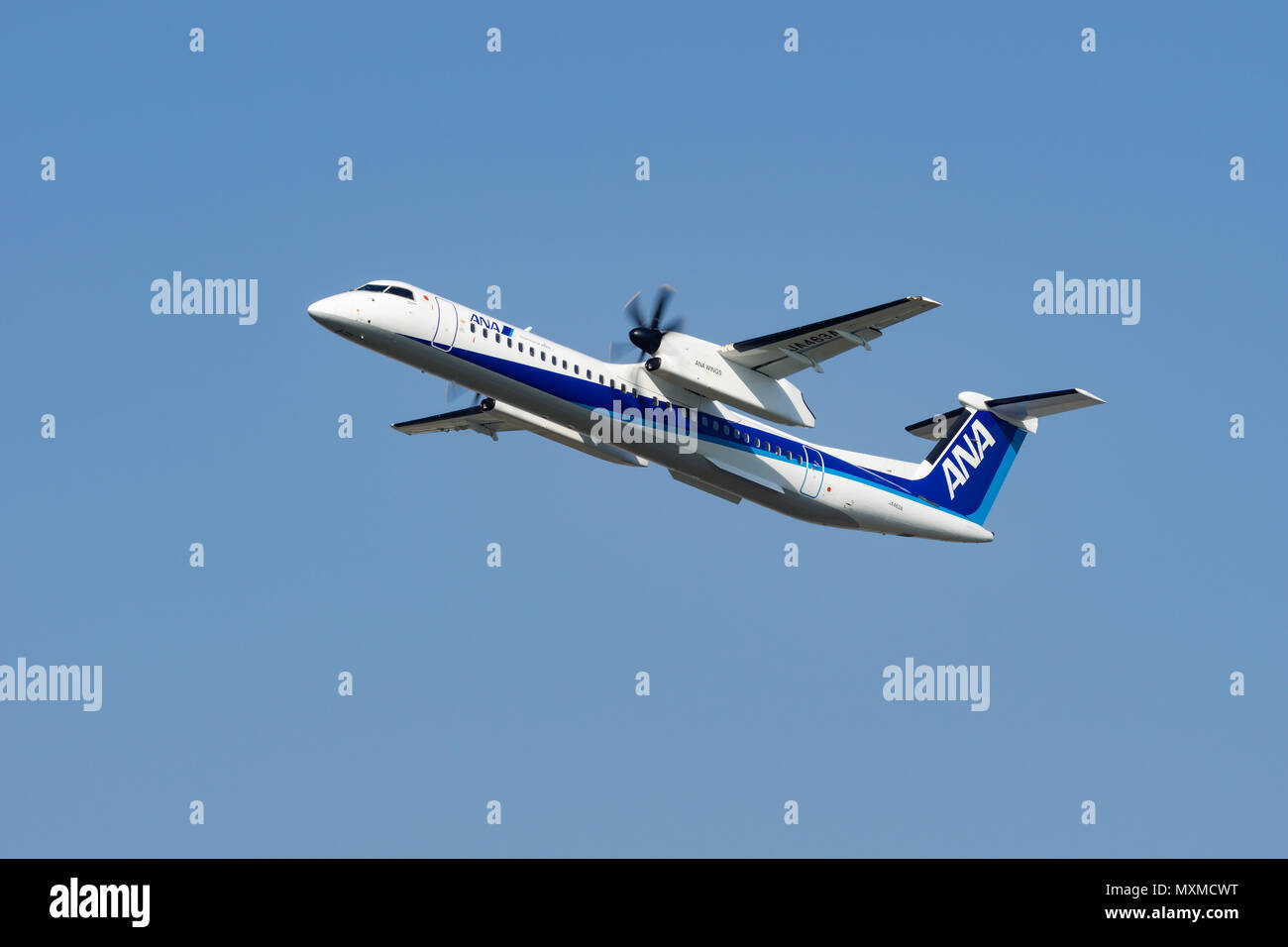 OSAKA, JAPAN - APR. 28, 2018: Bombardier DHC-8-400 Dash 8 taking off from the Itami International Airport in Osaka, Japan. - Stock Image