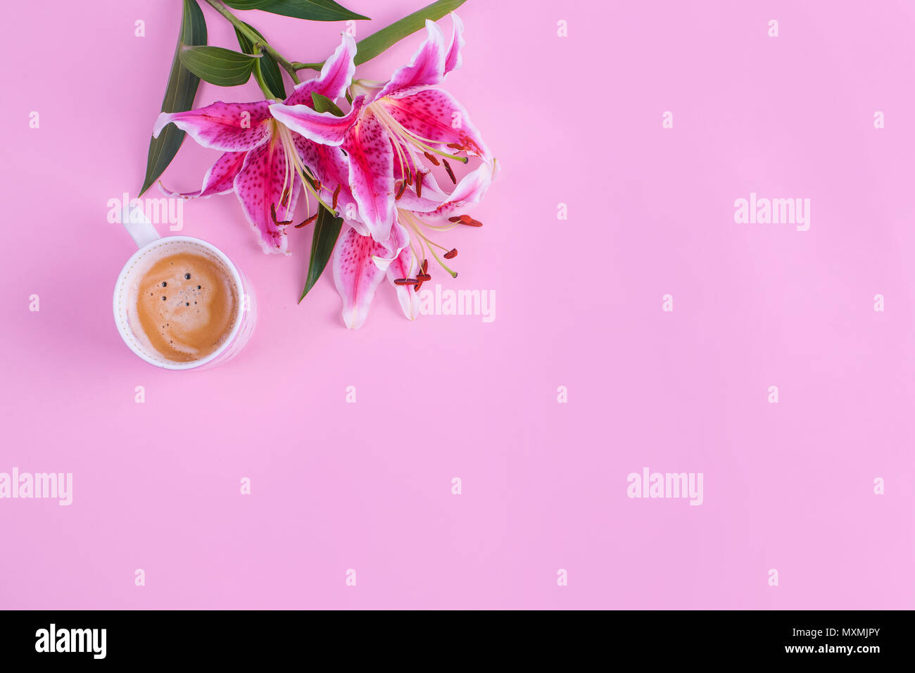 Pink Background Cup Of Morning Coffee And A Bouquet Of Flowers Of
