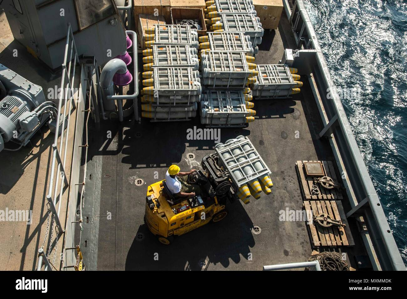 161117-N-RX777-008    ARABIAN GULF (Nov. 17, 2016) Dylan Rios moves ordnance in preparation for an upcoming replenishment-at-sea aboard the fast combat support ship USNS Arctic (T-AOE 8). Arctic is deployed supporting coalition maritime forces ships in the U.S. 5th Fleet area of operations. (U.S. Navy photo by Petty Officer 3rd Class Cole Keller) - Stock Image