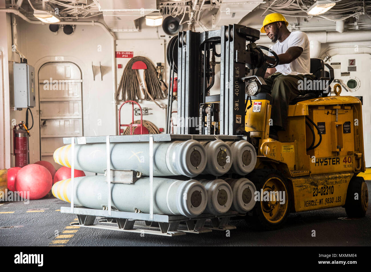 161117-N-RX777-012    ARABIAN GULF (Nov. 17, 2016) Dylan Rios moves ordnance in preparation for an upcoming replenishment-at-sea aboard the fast combat support ship USNS Arctic (T-AOE 8). Arctic is deployed supporting coalition maritime forces ships in the U.S. 5th Fleet area of operations. (U.S. Navy photo by Petty Officer 3rd Class Cole Keller) - Stock Image