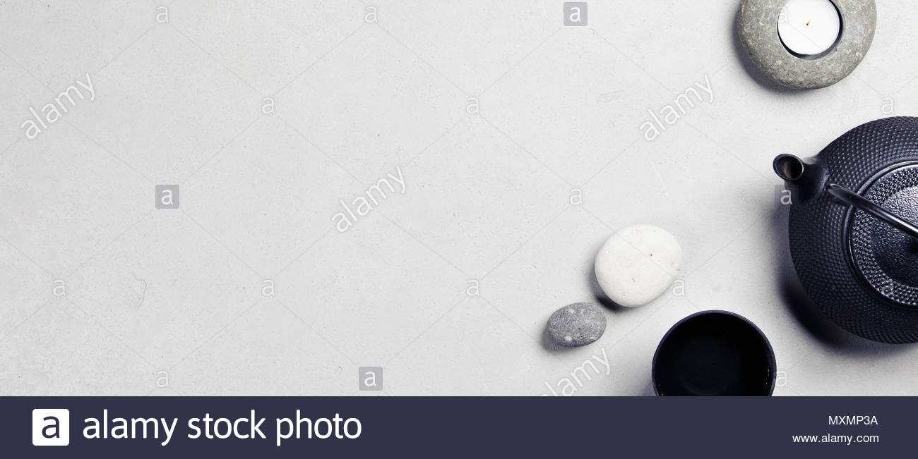Asian tea set and spa stones on concrete background. Natural spa treatment and relaxation concept. Top view, flat lay, copyspace Stock Photo
