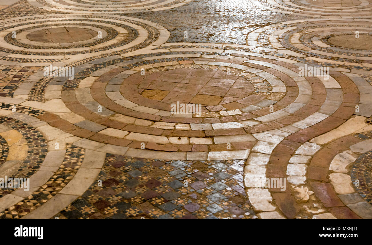 Interior of San Pietro Church, details of the Cosmatesque Pavements with geometric decorativ inlay - Stock Image