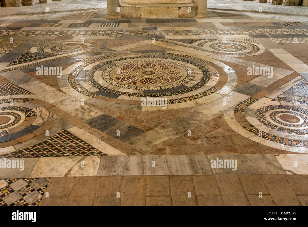 Tuscania (Viterbo), Italy - 2 may, 2018: Interior of San Pietro Church, details of the Cosmatesque Pavements with geometric decorativ inlay - Stock Image