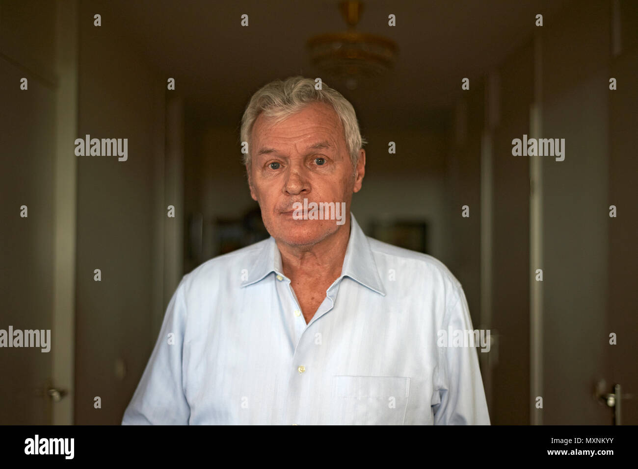 Portrait of an elderly man in a retirement home looking very lost and unsure as if he has forgotten things and has Alzheimer's - Stock Image