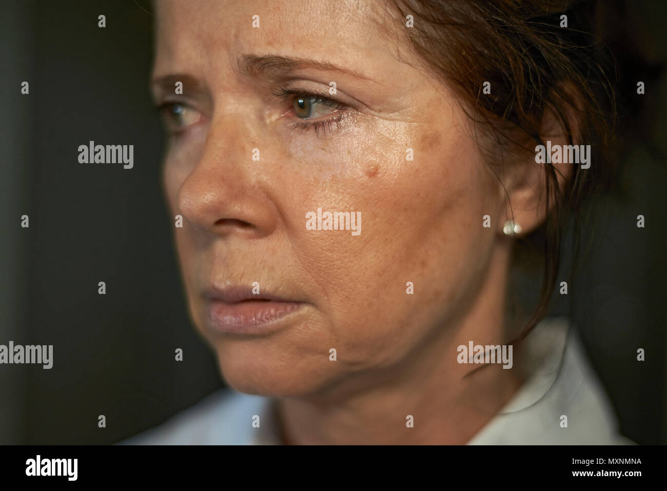 portrait of an elderly caucasian woman looking very lost and upset