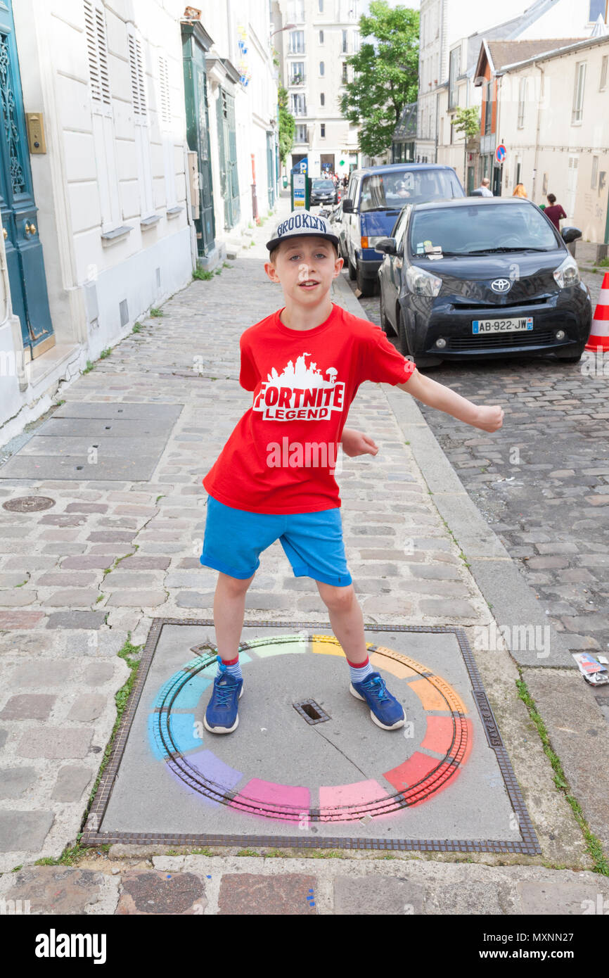 Nine year old boy flossing in Montmartre, Paris, France - Stock Image