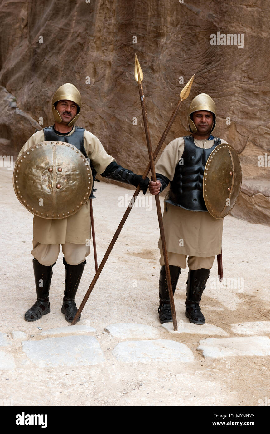 two nabataean soldiers in ancient armaments, entrance of Siq, canyon, Archaeological Park, Petra, Jordan, Minor Asia / Petra | zwei Soldaten in antike - Stock Image