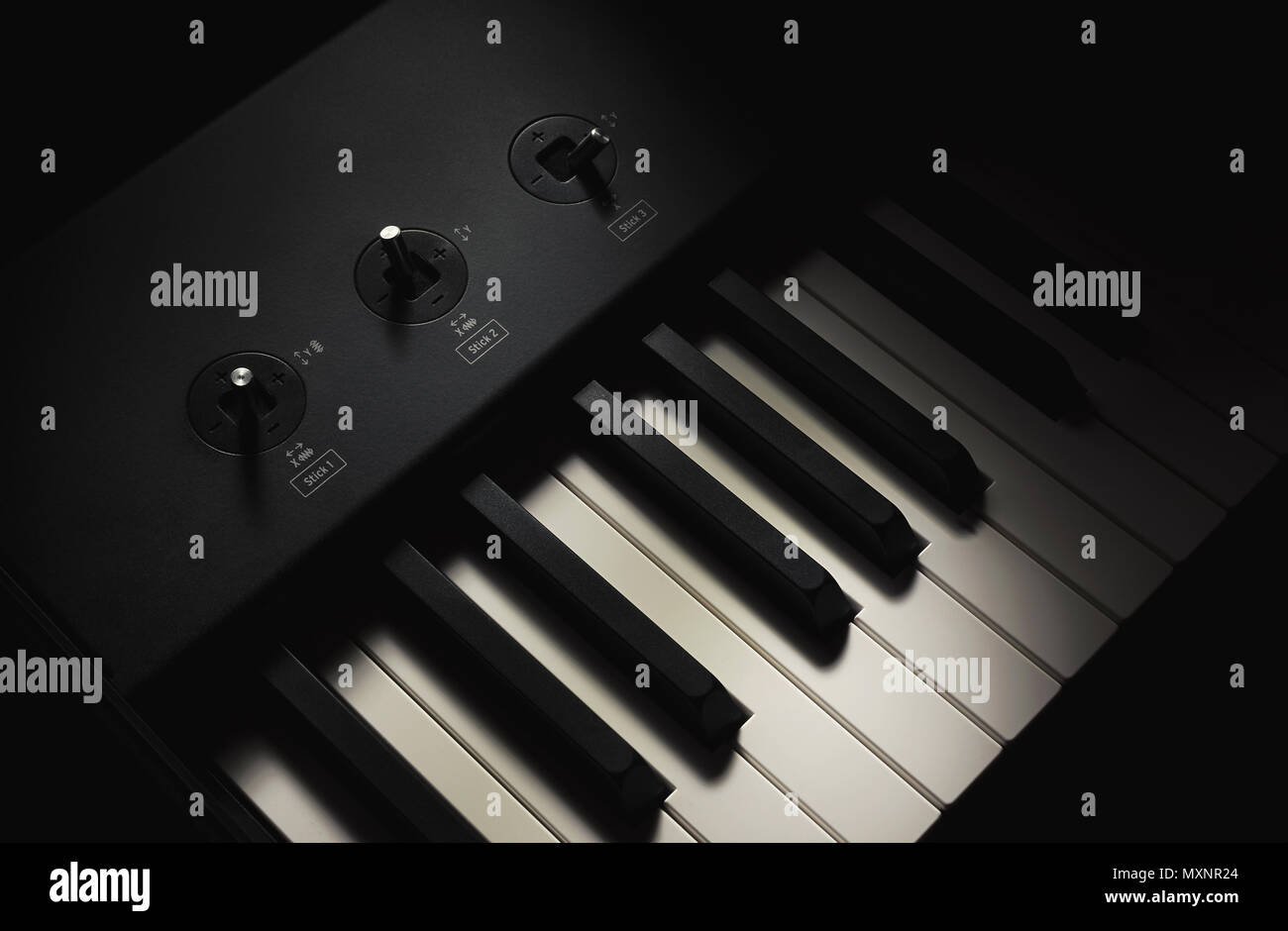 Black and white keys and controller sticks, part of modern midi keyboard. - Stock Image