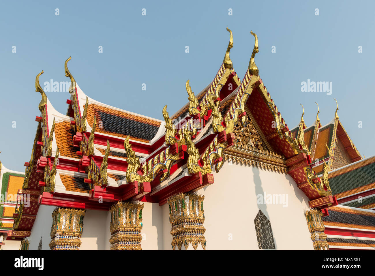 Ornate decorations  on the tops of the pagodas or chedis in the Wat Pho ,the Temple of the Reclining Buddha, or Wat Phra Chetuphon, Bangkok, Thailand - Stock Image
