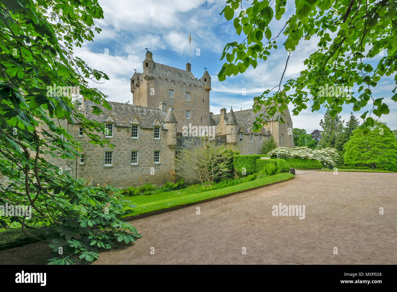 CAWDOR CASTLE NAIRN SCOTLAND THE MAIN BUILDING AND TREES IN SPRING - Stock Image