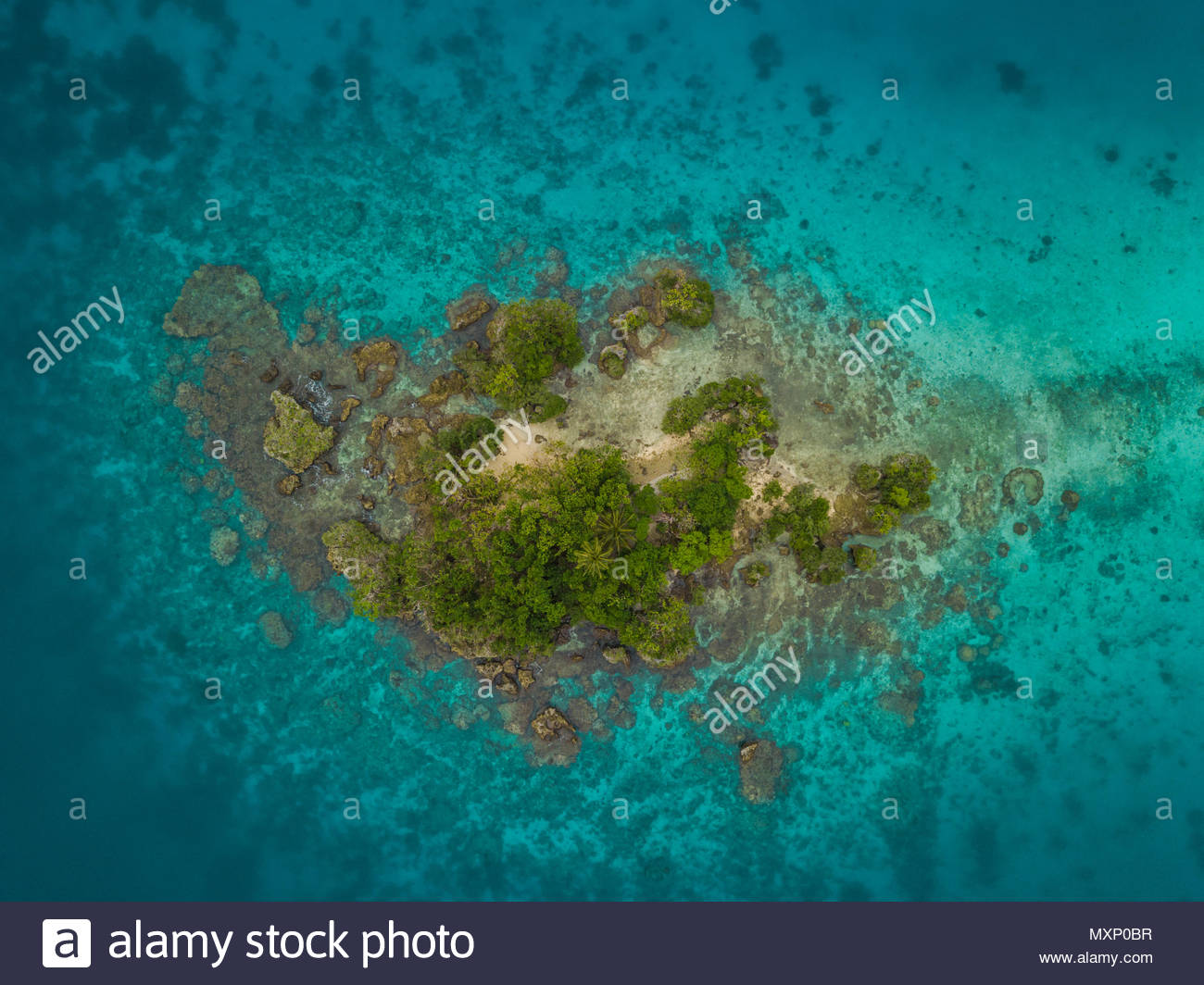 A Birds Eye View Of Tiny Island In The Tropical Blue Water Vanuatu