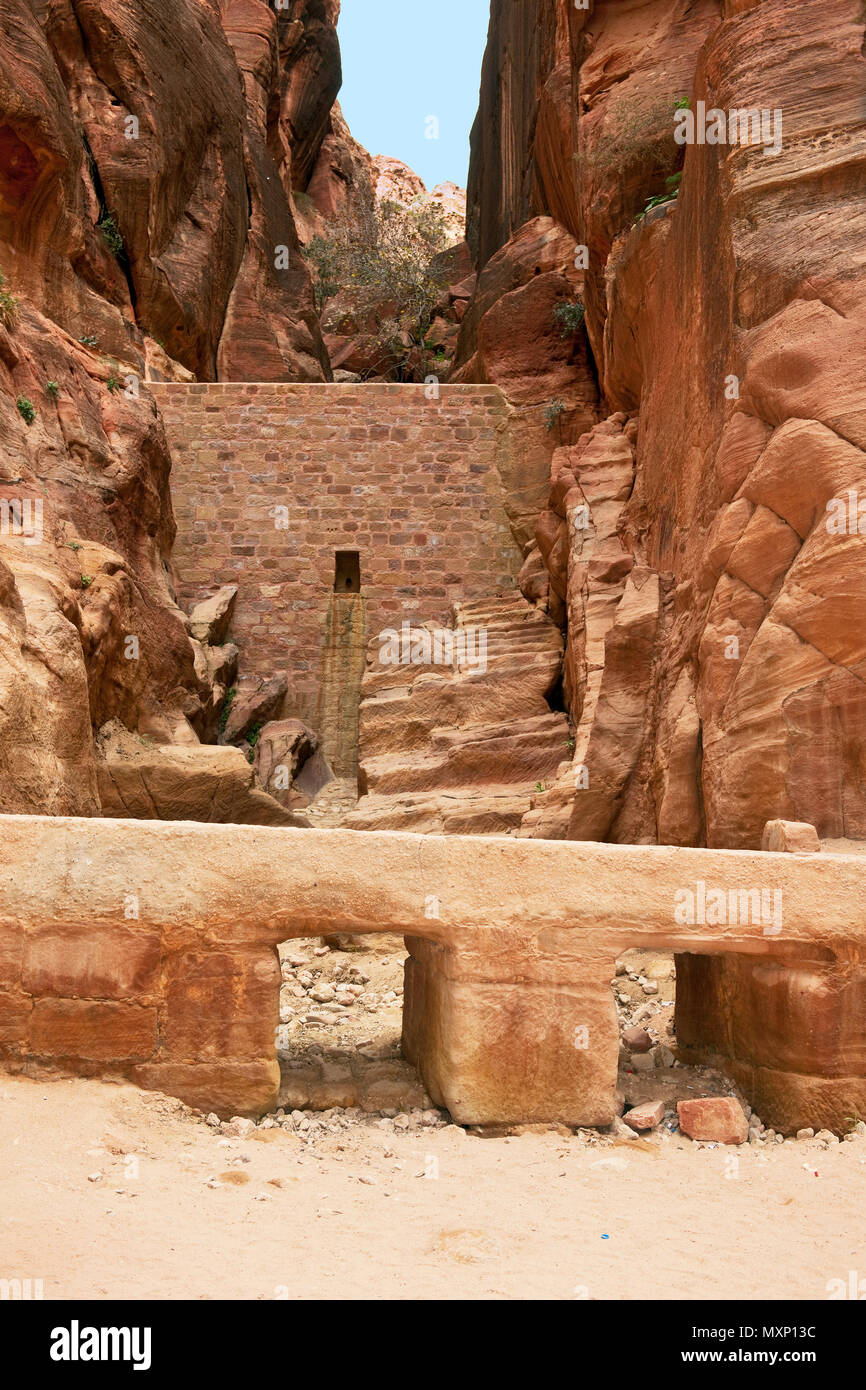 ancient watersupply and dam against flood in canyon, ancient pavestones, Siq of Petra, canyon of Petra Archaeological Park, Petra, Jordan, Asia Minor  Stock Photo