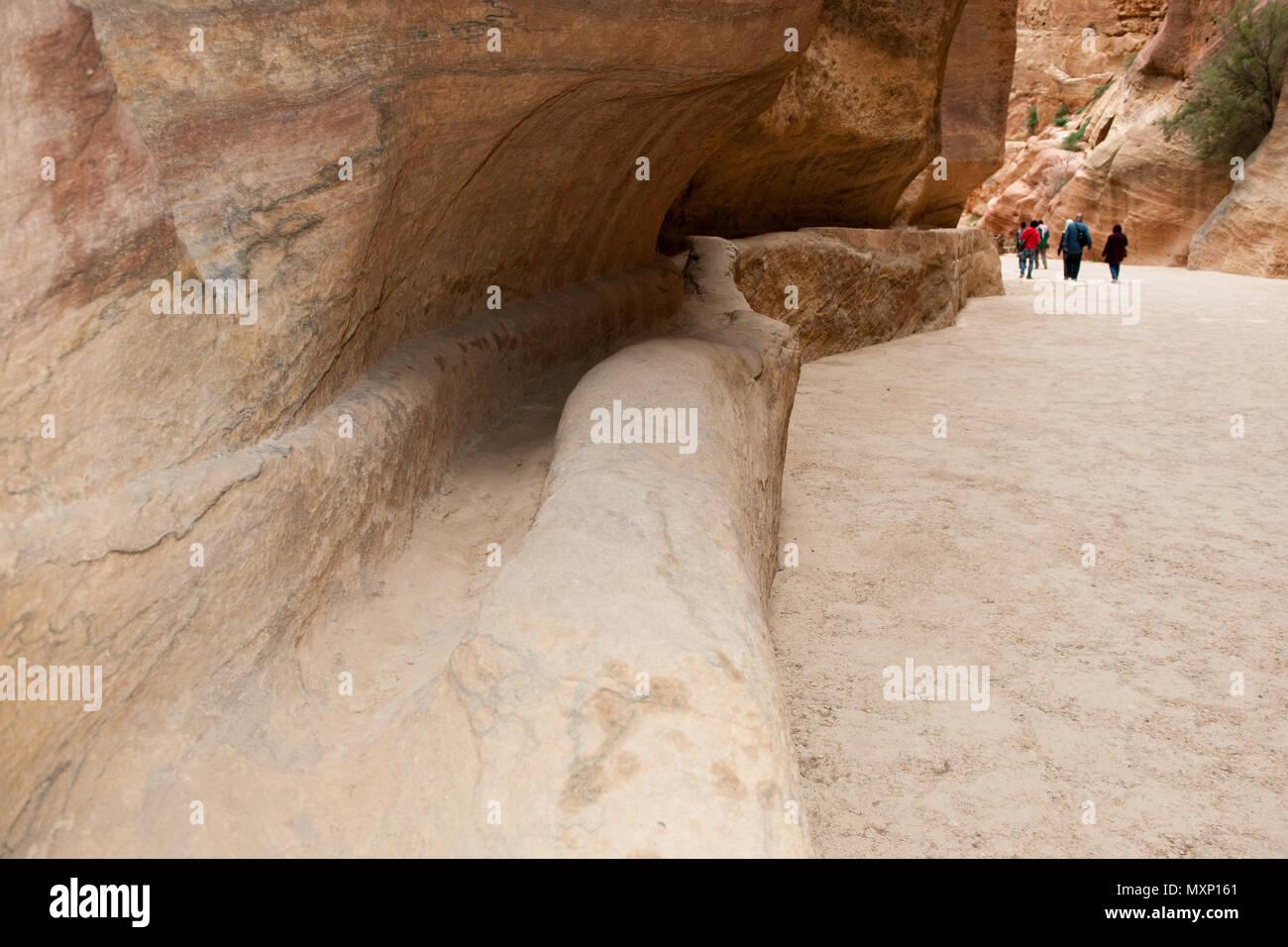 ancient watersupply in canyon, ancient pavestones, Siq of Petra, canyon of Petra Archaeological Park, Petra, Jordan, Asia Minor / Petra | antike Wasse Stock Photo