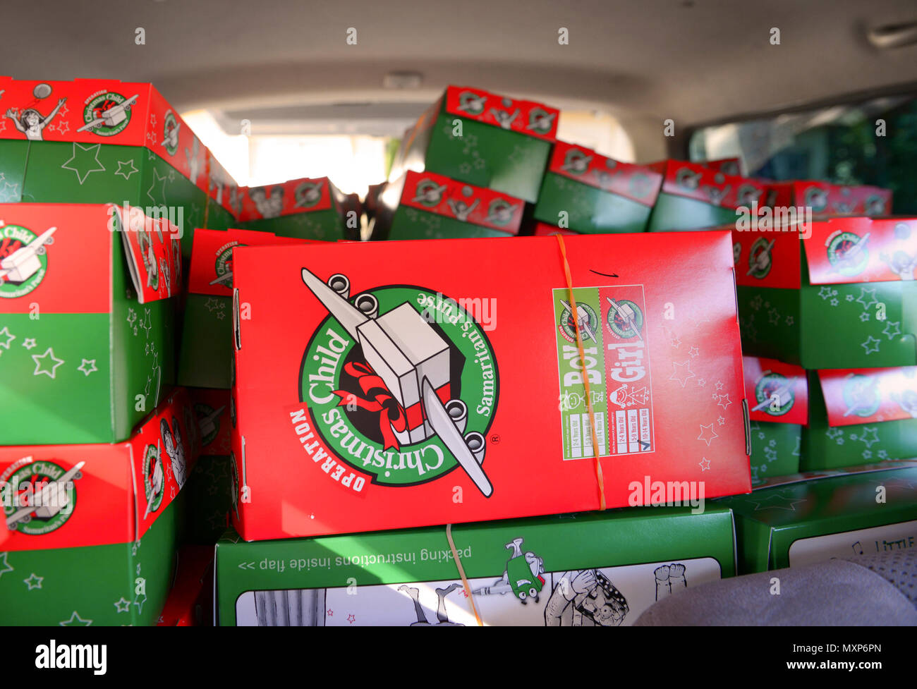 Gifts stacked in a van await delivery to children around the world ...