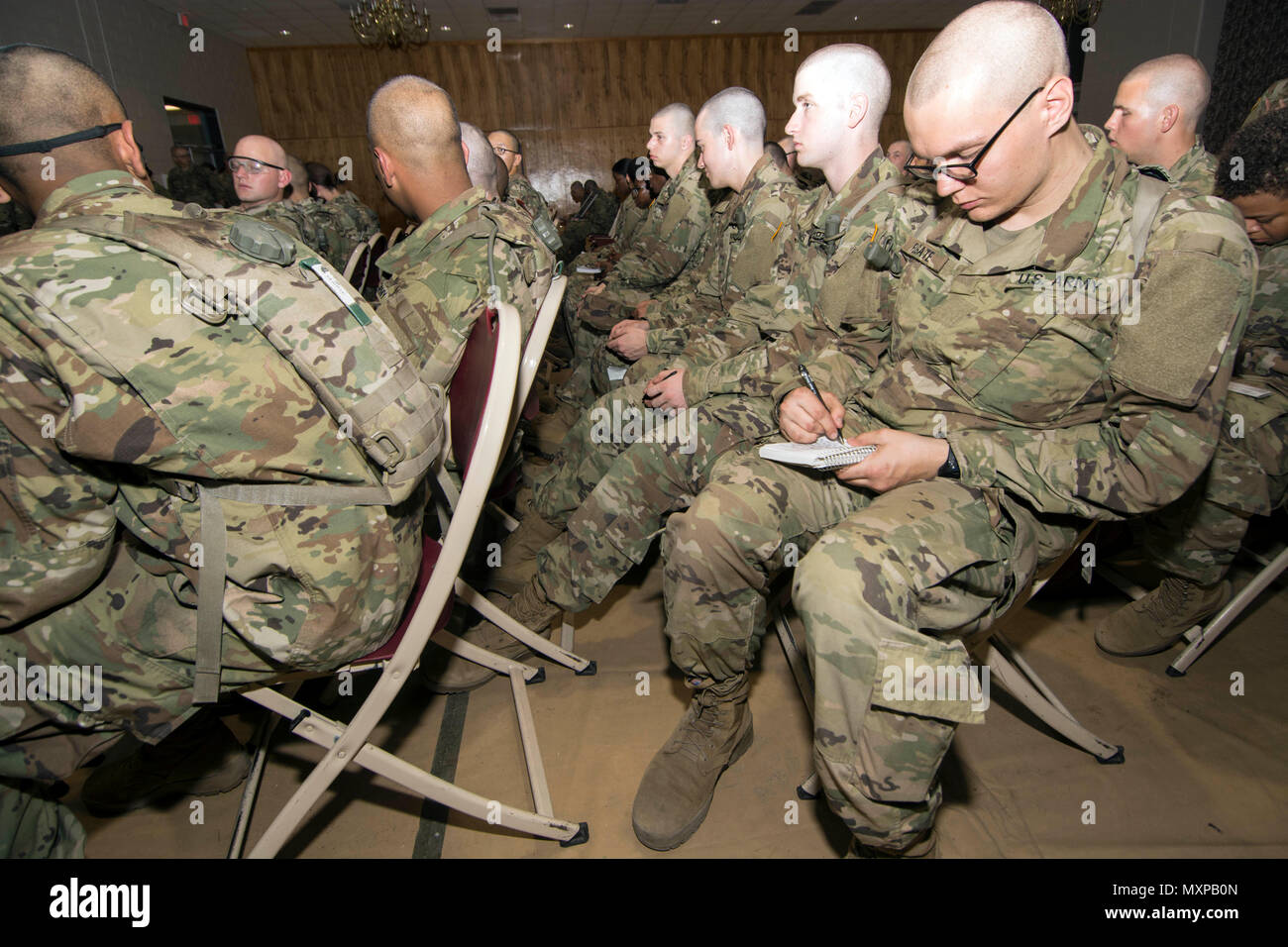 Victory block leave stock photos victory block leave stock images a soldier in training with 1st battalion 34th infantry regiment takes time to write a altavistaventures Image collections