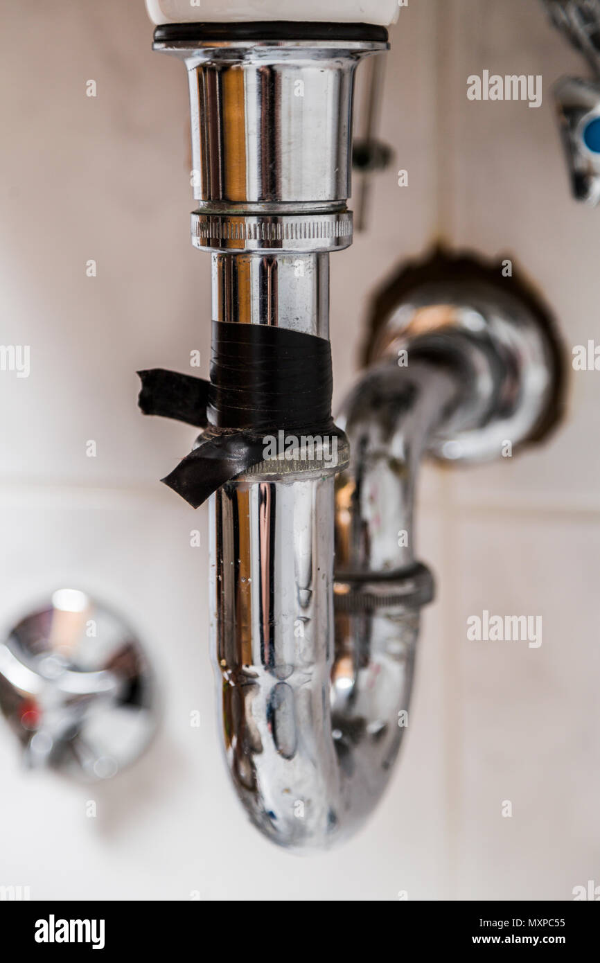 old flowing drainpipe in kitchen or bathroom Stock Photo