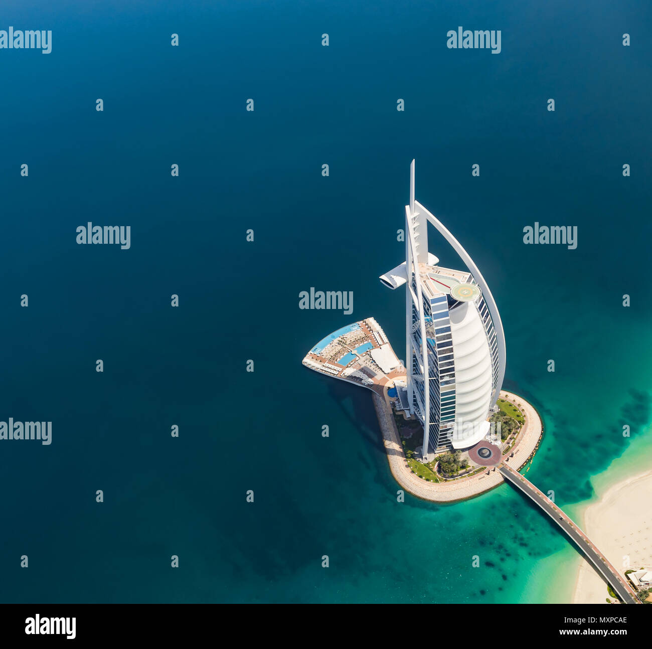 DUBAI, UAE - MARCH 2018: Aerial view of Burj Al Arab hotel in Dubai, one of the most luxury hotel in the world. Stock Photo