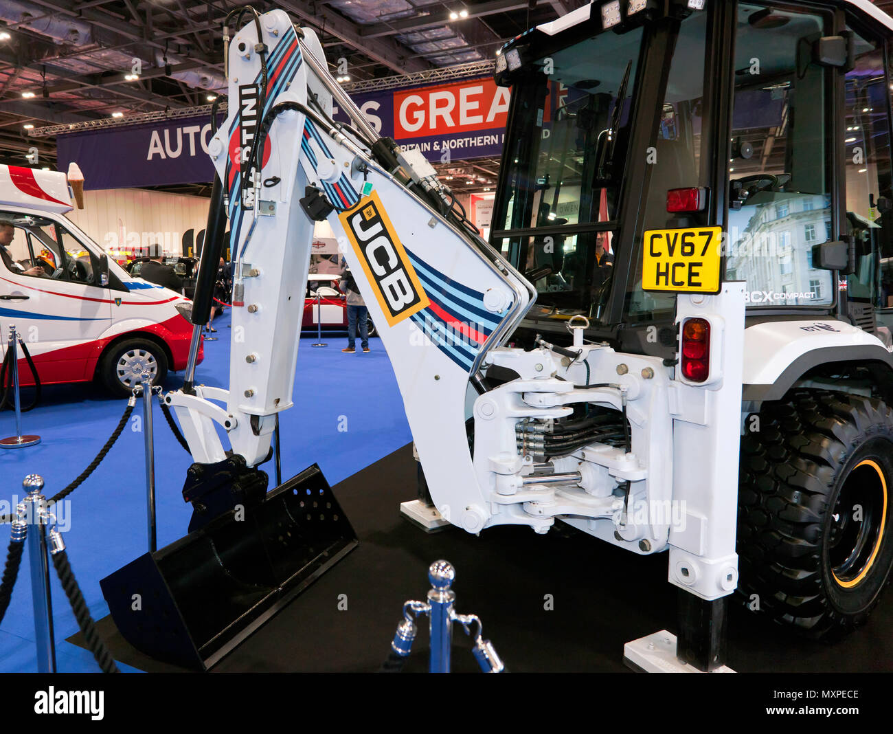 A JCB  Digger, with the 2018 Williams Martini Formula One Team Livery painted on it,  at the 2018 London Motor Show - Stock Image