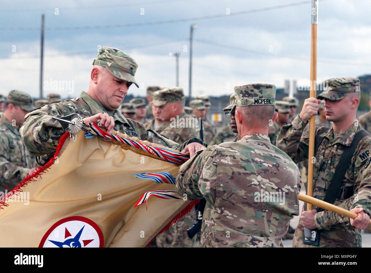 (Left) Brig. Gen. Robert D. Harter, Commanding General of the 316th Sustainment Command (Expeditionary), cases the 316th ESC guidon with Command Sgt. Maj. Johnny McPeek (Right), the 316th ESC Command Sergeant Major, during a Colors Casing ceremony at Fort Hood, Texas Nov. 28, 2016.  (U.S. Army photo by Sgt. Christopher Bigelow) - Stock Image