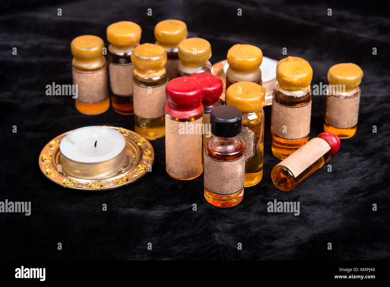 Lot of bottles with a magical potion on a dark background - Stock Image