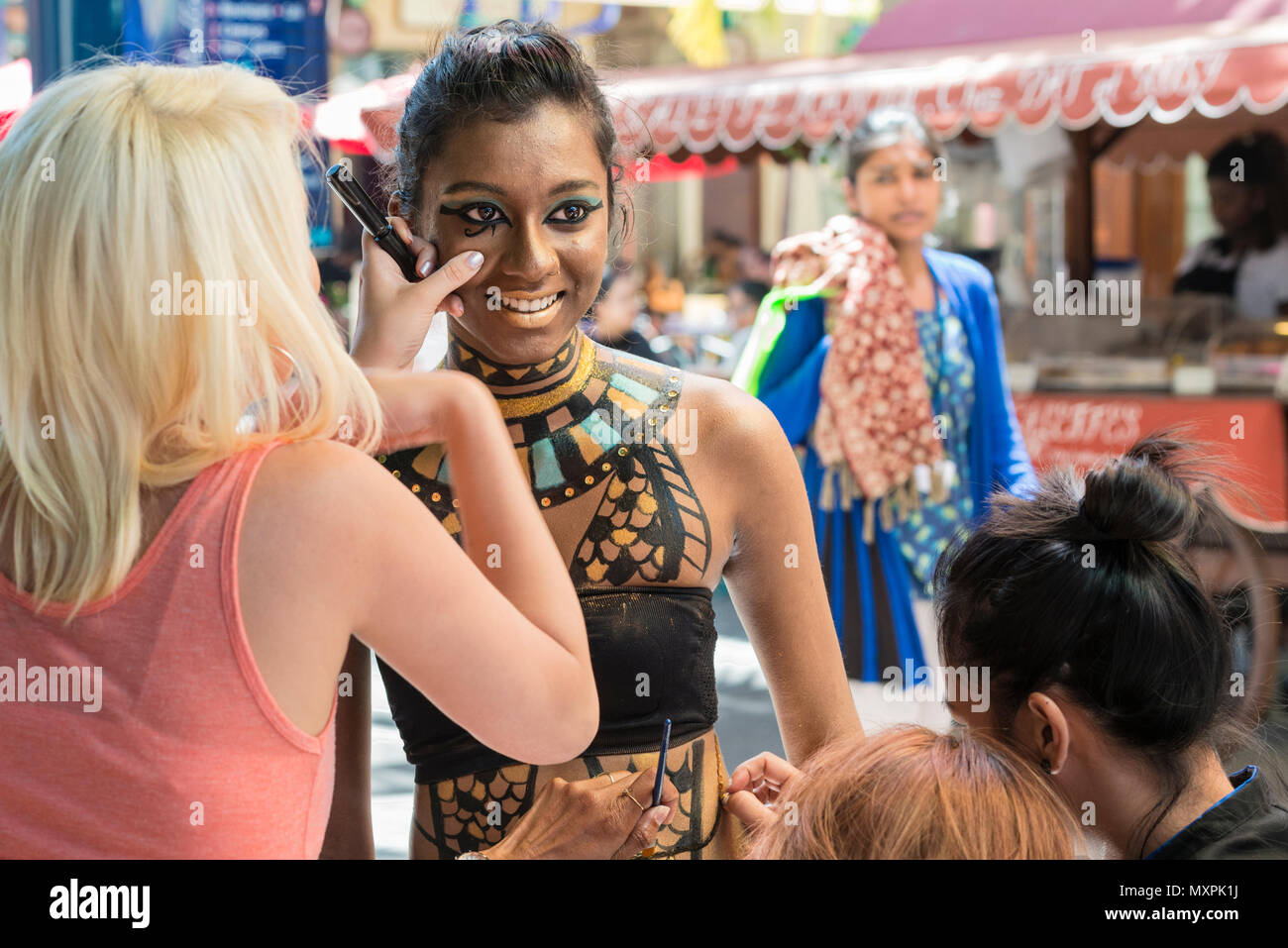 A public demonstration of face and body painting,  part of the 'Salon Fam De'Zil'. Caudan Waterfront, Port Louis, Mauritius. - Stock Image