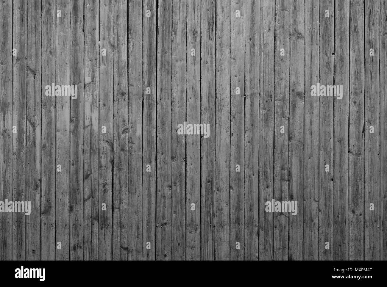 Wooden wall with vertical planks. Close up of an old wooden fence panels - Stock Image