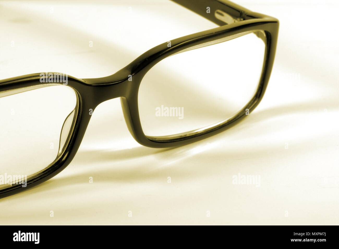 Black fashion reading glasses on white background. - Stock Image