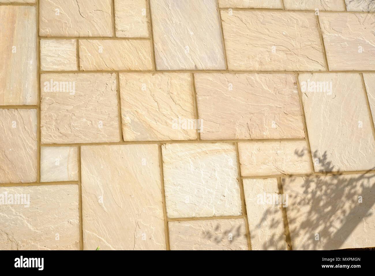 Sandstone patio slabs newly laid. Stock Photo