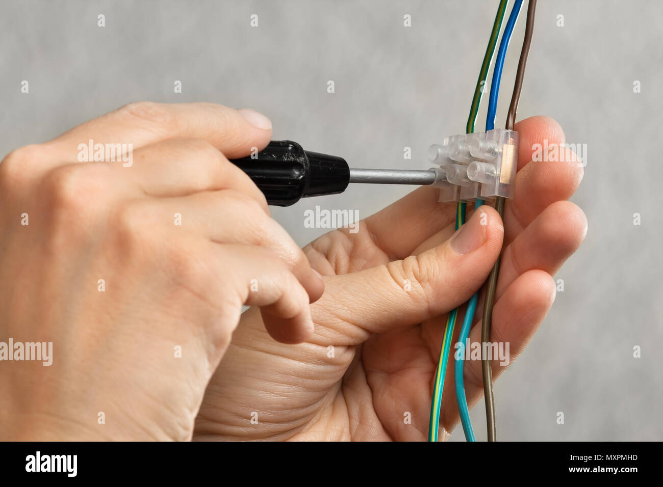 Wire Connector Terminal Block Stock Photos Auto Wiring Blocks Hands Connecting Wires In With Screwdriver Image