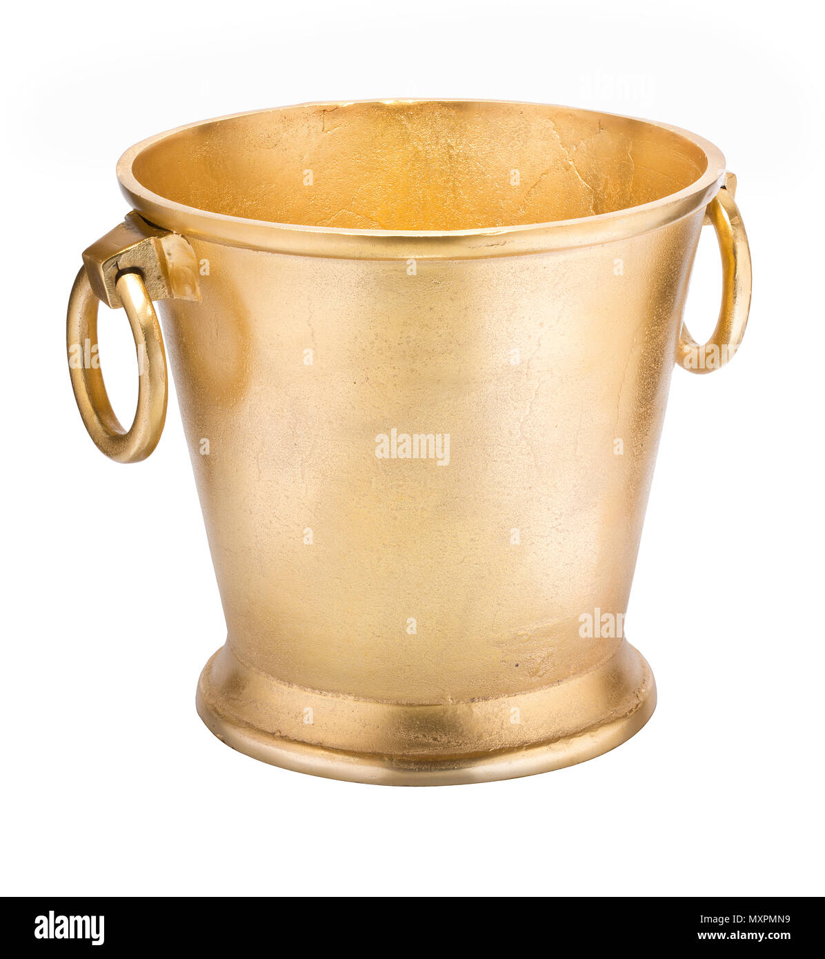 Gold coloured metal ice bucket, for cooling wine bottles or other drinks. - Stock Image