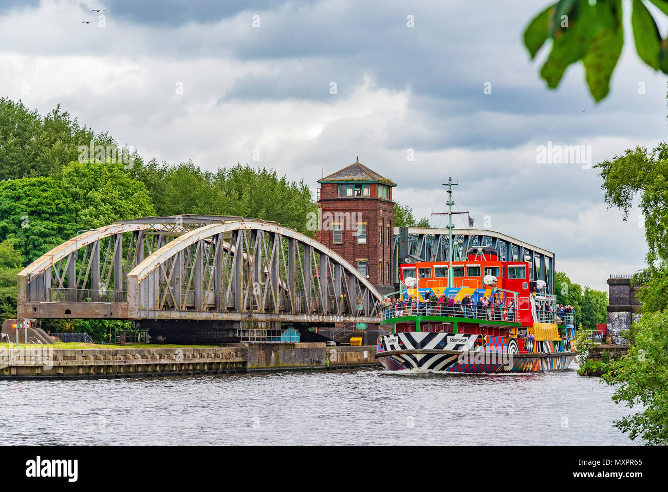 Barton road bridge and aqueduct on the Manchester Ship Canal. Mersey Ferries Dazzle ferry Snowdrop passing through. - Stock Image